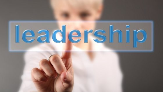 A woman pointing to the word leadership