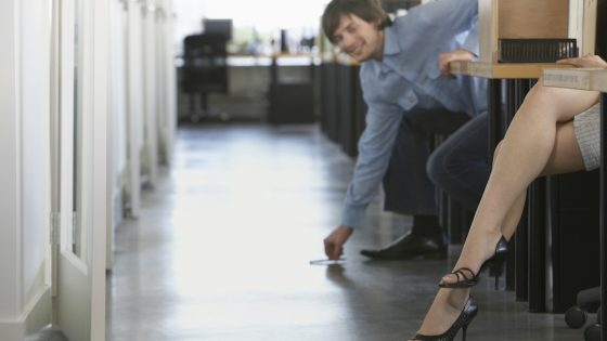A woman experiencing sexual harassment at work