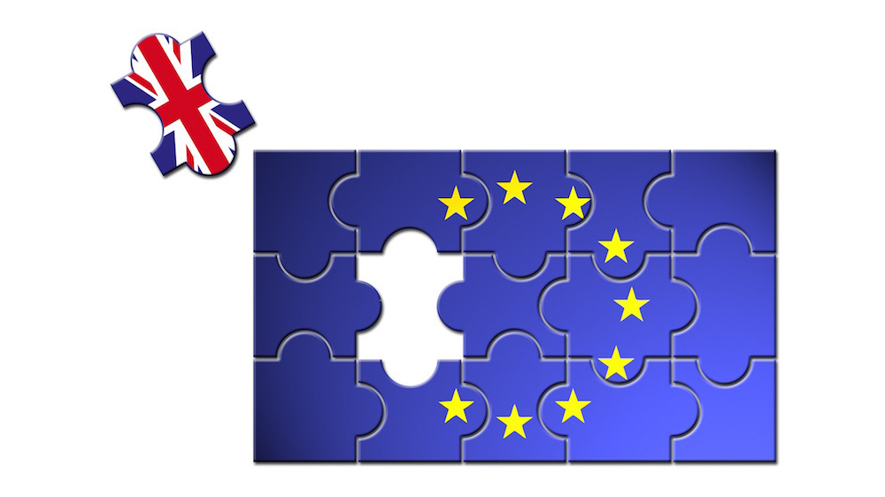 UK puzzle piece coming out of EU flag to represent Brexit