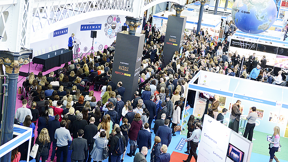 Visitors browse exhibitor stands at International Confex