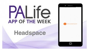 A phone that shows the Headspace logo