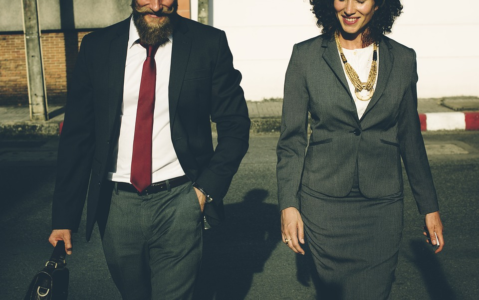 Man and Woman both dressed work smart