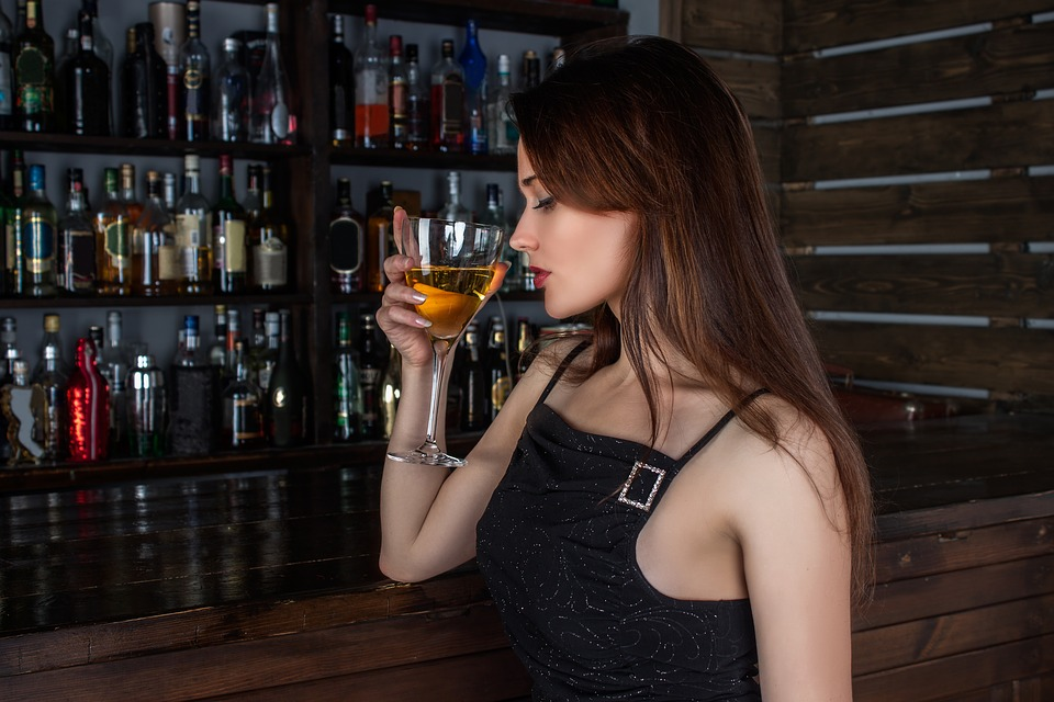 Picture of a lady having a drink at a bar