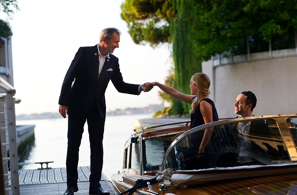 Guests being welcomes via boat to the hotel