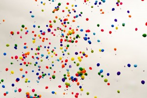 hundreds of colourful balloons in the air - to represent a celebration