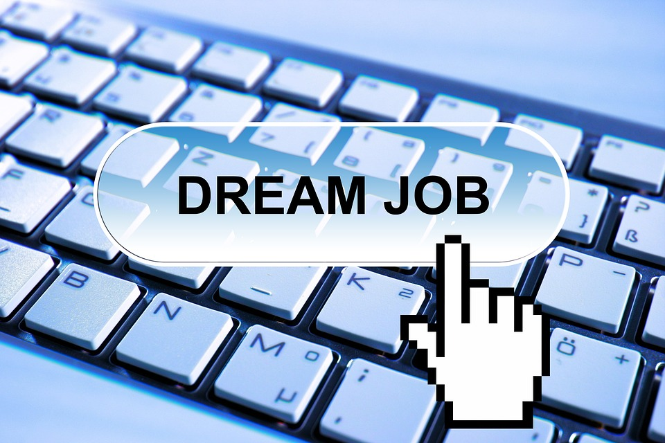 A computer keyboard with a button saying Dream Job