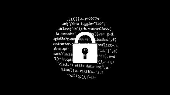 a padlock over computer coding