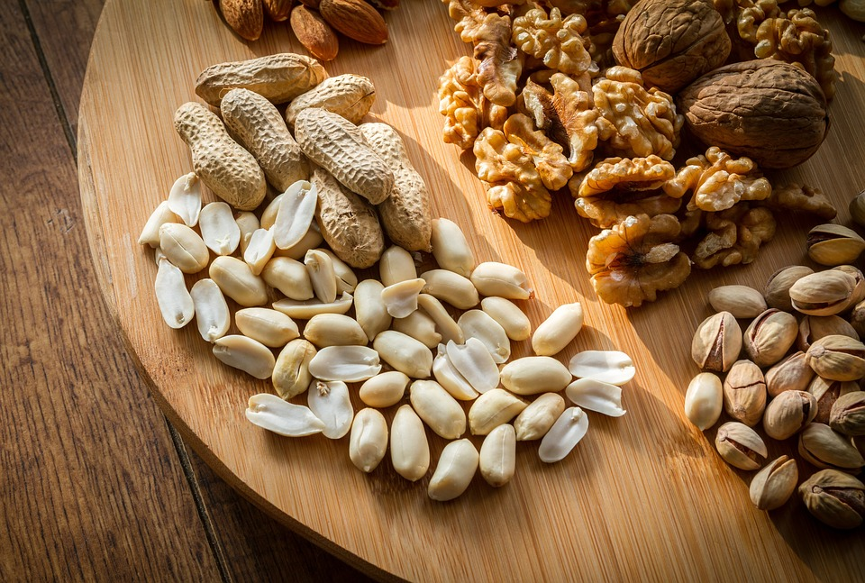 A board of mixed nuts for someone to snack on